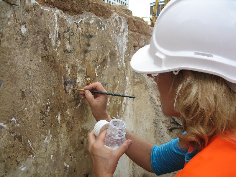 Conservator working on a World War II air raid bunker now held in the Queensland Museum collection